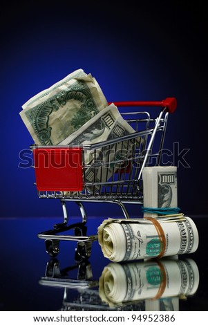 Market cart over color background - stock photo