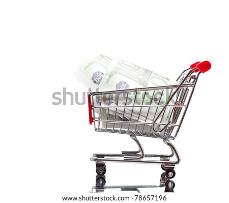 Market cart with money - stock photo