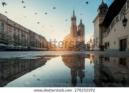Market square and St. Mary's Basilica in Krakow, Poland. - stock photo