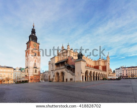 Market square with sukennice and cityhall tower in Krakow at day, Poland - stock photo