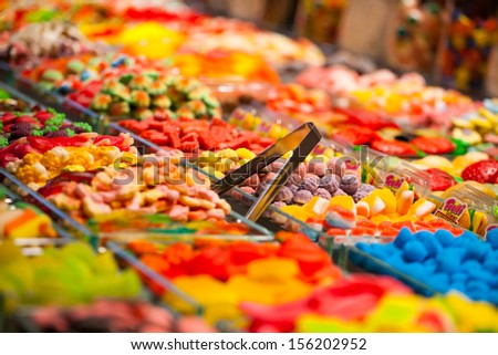 Market stall full of candys in La Boqueria Market. Barcelona. Catalonia.  - stock photo