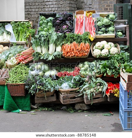 Market stall with variety of organically grown vegetables - stock photo