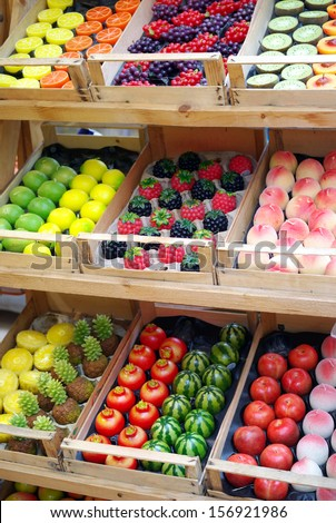 Market stand of decorative candles shaped tropical fruits