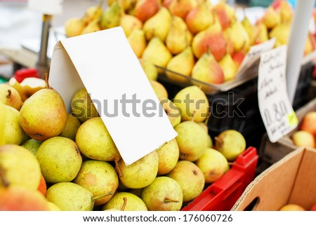 Market stolls with pears - stock photo