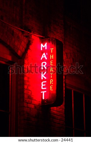 market theater neon sign taken in time laps (bulb exposure) for maximum effect - stock photo