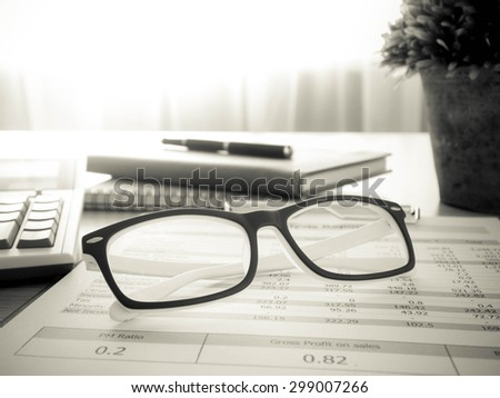 Marketer's desk with analysis Report,glasses ,Calculator.selective focus. - stock photo