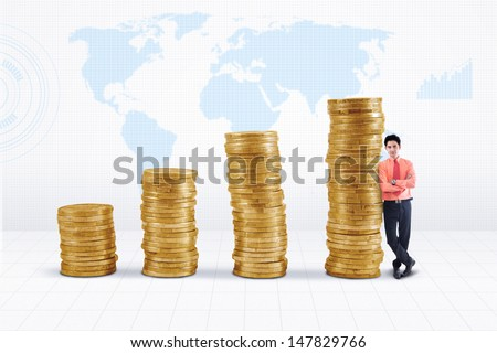 Marketing agent and rising gold coins chart on world map background - stock photo