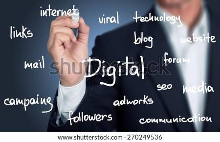 Marketing. Business man writing digital marketing concept - stock photo