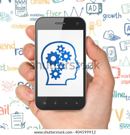 Marketing concept: Hand Holding Smartphone with  blue Head With Gears icon on display,  Hand Drawn Marketing Icons background, 3D rendering - stock photo
