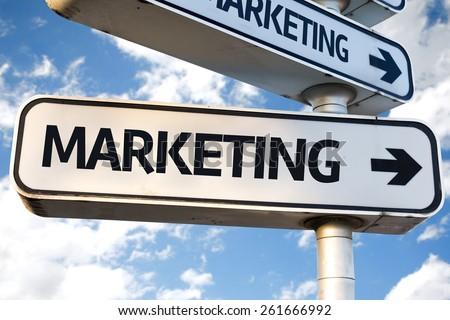 Marketing direction sign on sky background - stock photo
