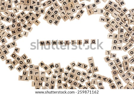 marketing framed by small wooden cubes with letters isolated on white background - stock photo