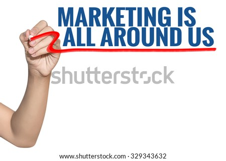 Marketing is All Around Us word write on white background by woman hand holding highlighter pen - stock photo