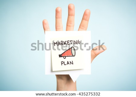 Marketing plan concept. Sticky note illustrated with a megaphone. Top five reasons. Open hand up holding speech bubble with message on blue background. - stock photo