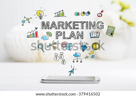Marketing Plan concept with smartphone on white table - stock photo