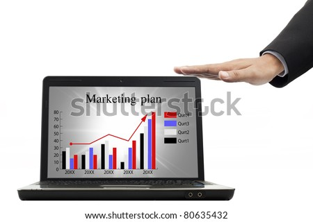 Marketing plan for success in the notebook - stock photo