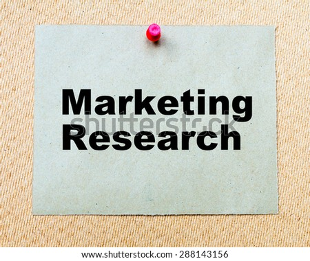 Marketing Research written on paper note pinned with red thumbtack on wooden board. Business conceptual Image - stock photo