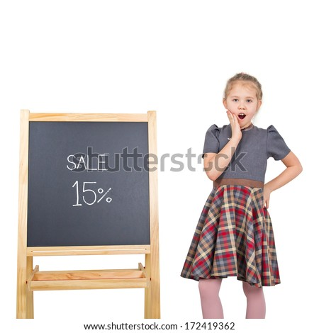 Marketing sale concept. Colorful studio portrait of beauty little girl with chalkboard isolated on white background. Chalkboard with sale text. (isolated with clipping path) - stock photo