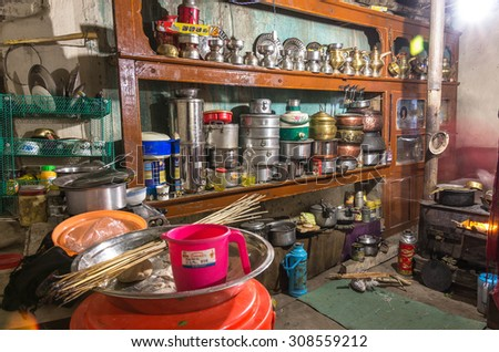 MARKHA VALLEY, INDIA - JULY 29, 2014: a traditional Ladakhi kitchen. as the main living room in the house, great care is taken in the decoration of Ladakhi kitchen - stock photo