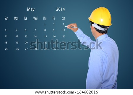 marking new year day on calendar May 2014. - stock photo