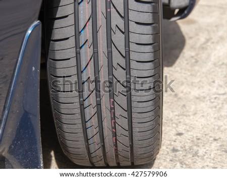 Marking tires - stock photo