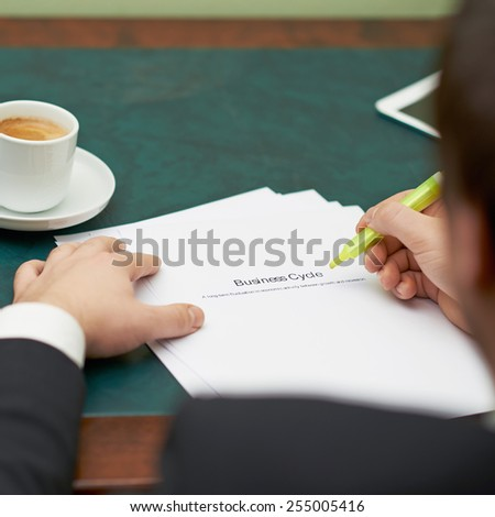 Marking words in a business cycle definition, shallow depth of field composition - stock photo
