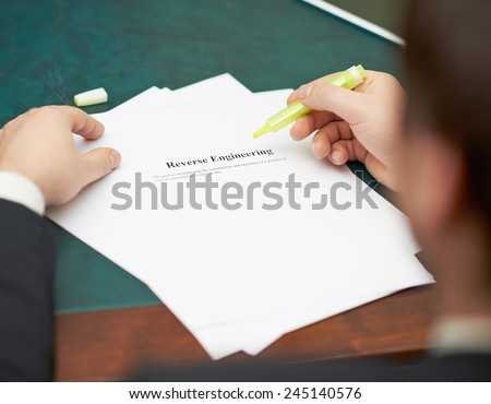 Marking words in a reverse engineering definition, shallow depth of field composition - stock photo