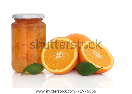 Marmalade jam in a jar with orange fruit whole and in halves with leaf sprigs, over white background. - stock photo