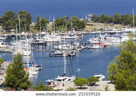 MARMARAS, GREECE- JULY 29, 2014: Porto Carras marina with sailboats and fishing boats in Chalkidiki, Greece. The Porto Carras marina is the largest private marina of northern Greece.