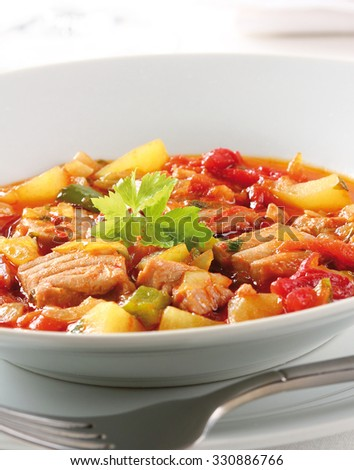 Marmitako, a spanish tuna stew with potatoes and peppers from the basque country. - stock photo