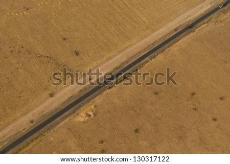 Maroc road in the desert near Marrakech aerial view - stock photo