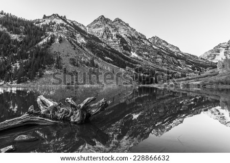 Maroon Bells and its Reflection in the Lake Black and White photo - stock photo
