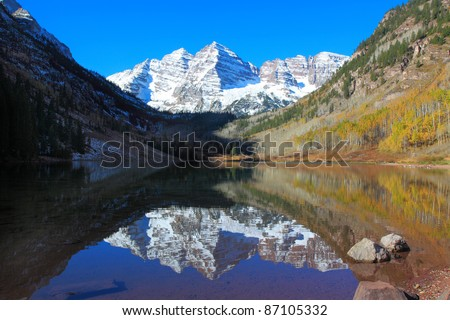 Maroon Bells in morning  light, from Maroon Lake - stock photo