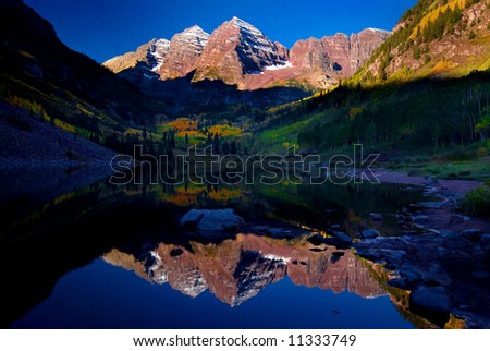 Maroon Bells Mountain Peaks reflected in Maroon Lake near Aspen, Colorado - stock photo