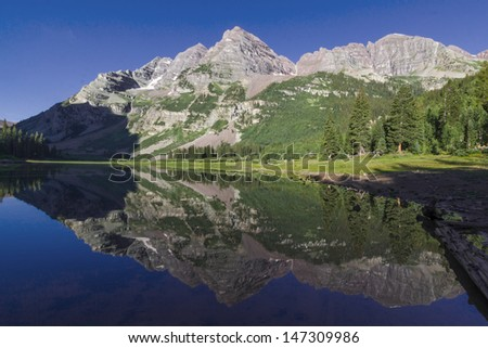 Maroon Bells near Aspen in the Colorado Rocky Mountains - reflection in Crater Lake. - stock photo
