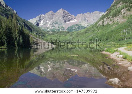 Maroon Bells near Aspen in the Colorado Rocky Mountains - reflection in Maroon Lake. - stock photo