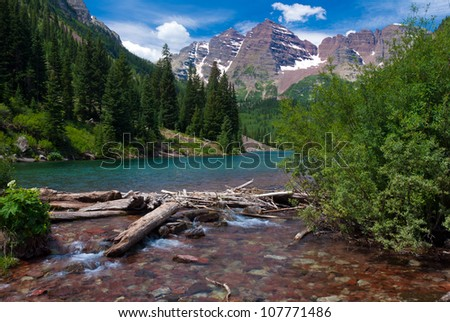 Maroon Bells Peaks at Maroon Lake with logs, Summer 2012 - stock photo
