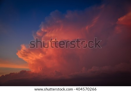 maroon clouds on sunset  - stock photo