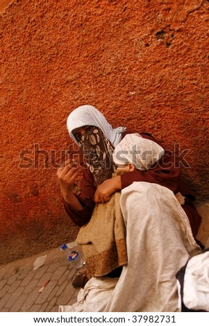 MARRAKECH, MOROCCO-APRIL 24:A mother with baby beg on the street April 24, 2009 in Marrakech.A 2009 study shows 4 million Moroccans live below the national poverty line, 3 million are from rural areas