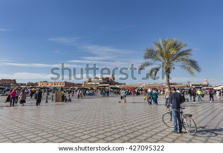 MARRAKECH, MOROCCO - APRIL 23, 2016: Jamaa el Fna (Jemaa el-Fnaa, Djema el-Fna or Djemaa el-Fnaa) square and market place in Marrakesh's medina quarter - stock photo