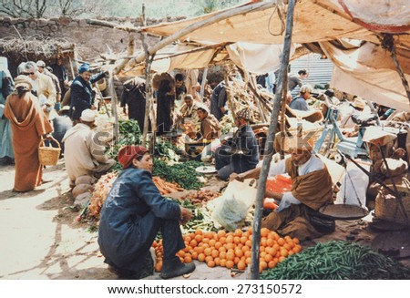 MARRAKECH, MOROCCO - CIRCA 1990: People at a traditional street food market - stock photo