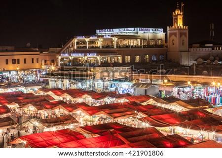 MARRAKECH, MOROCCO - FEBRUARY 22, 2016: Jemaa el Fna (also Jemaa el-Fnaa, Djema el-Fna or Djemaa el-Fnaa) is a square and market place in Marrakesh's medina quarter. - stock photo