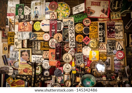 MARRAKECH, MOROCCO- MARCH 19: collection of signs, banner and number plates in Marrakech, Morocco, on 19, mar, 2013. In the souk you can find all kind of vintage memories - stock photo