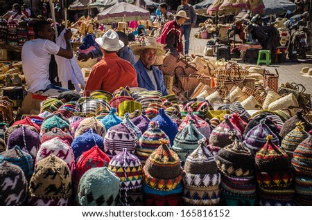 MARRAKECH, MOROCCO - MARCH 19: unidentified man sells colorful hats in the medina of Marrakech, Morocco, on 19 March, 2013. - stock photo