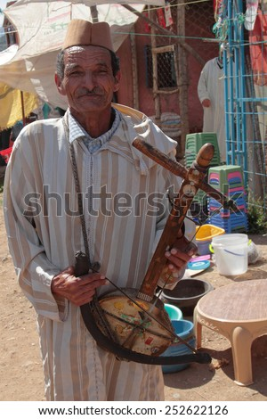 MARRAKECH, MOROCCO, MAY 9, 2013 : Unidentified musician in the streets of Marrakesh. Marrakesh is one of the most touristic place in Morocco. - stock photo