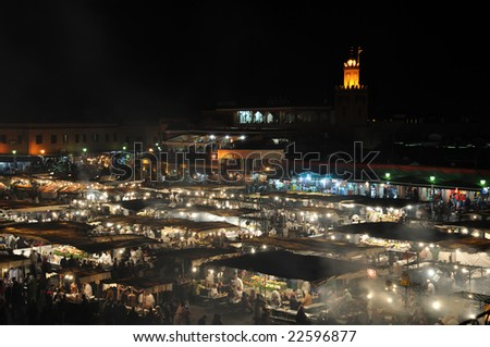 MARRAKECH, MOROCCO - NOV 22:  Food stalls at Djemaa el Fna square at night. November 22, 2008 in Marrakech, Morocco - stock photo