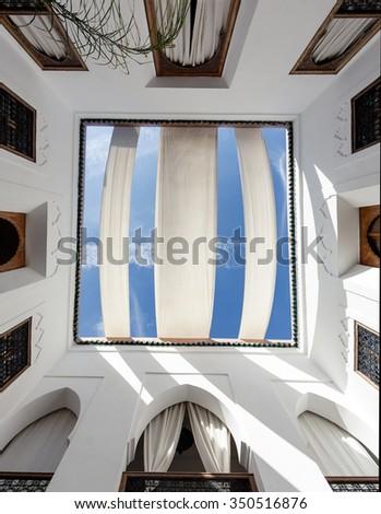 MARRAKECH, MOROCCO - OCTOBER 27, 2015: Traditional riad interior in Marrakech medina near the UNESCO square Djemaa El-fna at Marrakesh, Morocco - stock photo