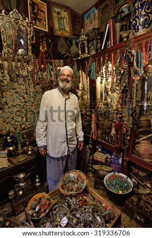 MARRAKESH - AUGUST 08: Unknown man in a market (souk), August 08, 2015 in a Marrakesh, Morocco. The traditional Berber market is one of the most important attractions of the city Marrakesh, Morocco - stock photo