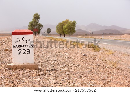 Marrakesh 229 kilometers - roadside distance indicator on the road to Marrakesh, Morocco - stock photo