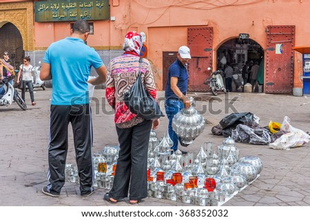 MARRAKESH, MOROCCO, APRIL 3, 2015: Jemaa el-Fnaa square - stand with souvenirs - stock photo