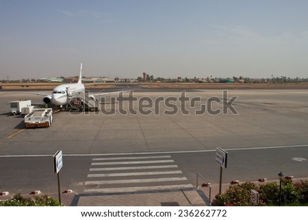 MARRAKESH, MOROCCO - AUGUST 9: Airplane at Menara International Airport at August 9, 2010 in Marrakesh, Morocco. The airport served over 3.1 million passengers in the year 2008. - stock photo